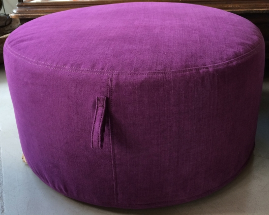 "30"" pouf from verellen in washable cotton-linen blend - this is the amazing color CROCUS - dramatic with charcoal, edgy with flax + natural  also on the floor - 30"" pouf in a medium brindles hide and a buttery charcoal leather"