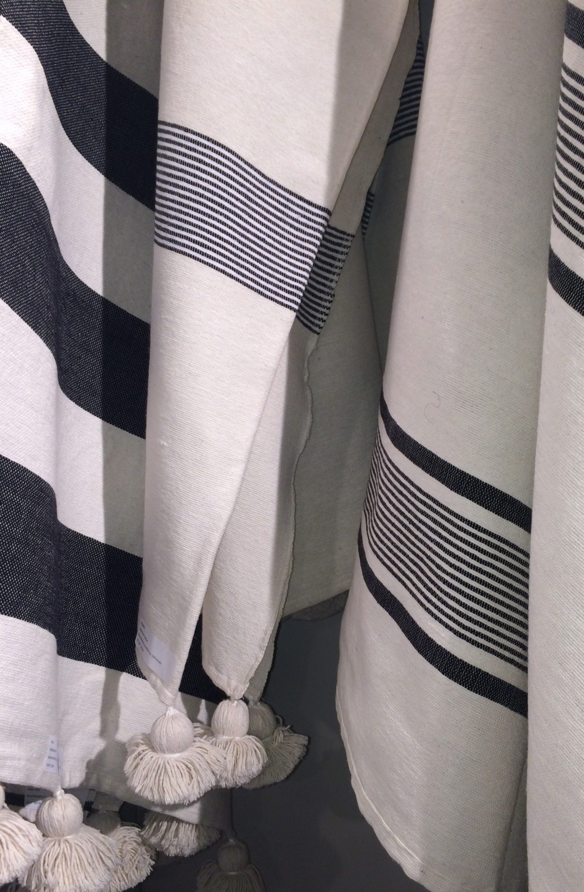 casual luxury...cotton throws in ivory + navyblack and a bit of white; hefty weave...gorgeous on a linen sofa, the back of an adirondack chair...perfect for chilly spring + summer evenings
