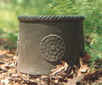 maynard round - lovely with topiaried trees, moss or large geraniums - no limit