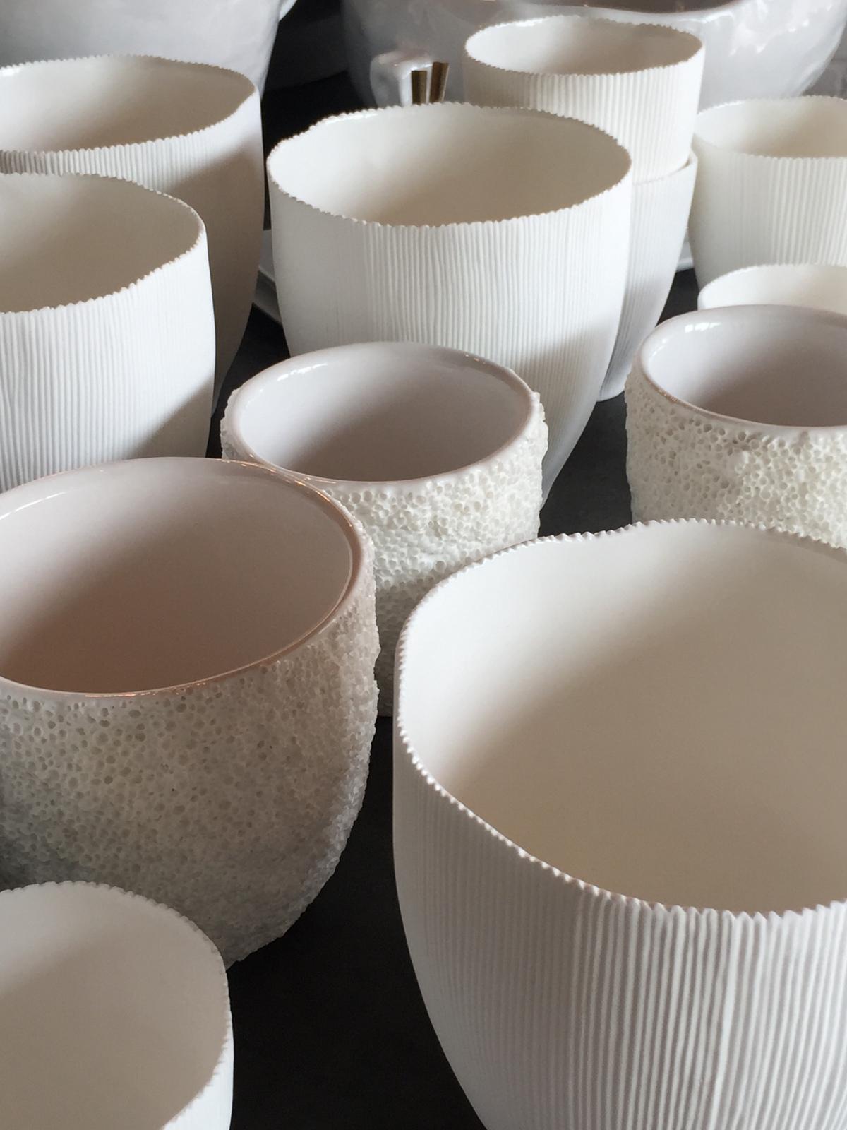 porcelain + clay votives, vases or vessels...textural