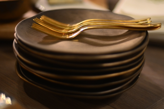Aura Dessert Plates stacked with Rocco Gold Forks