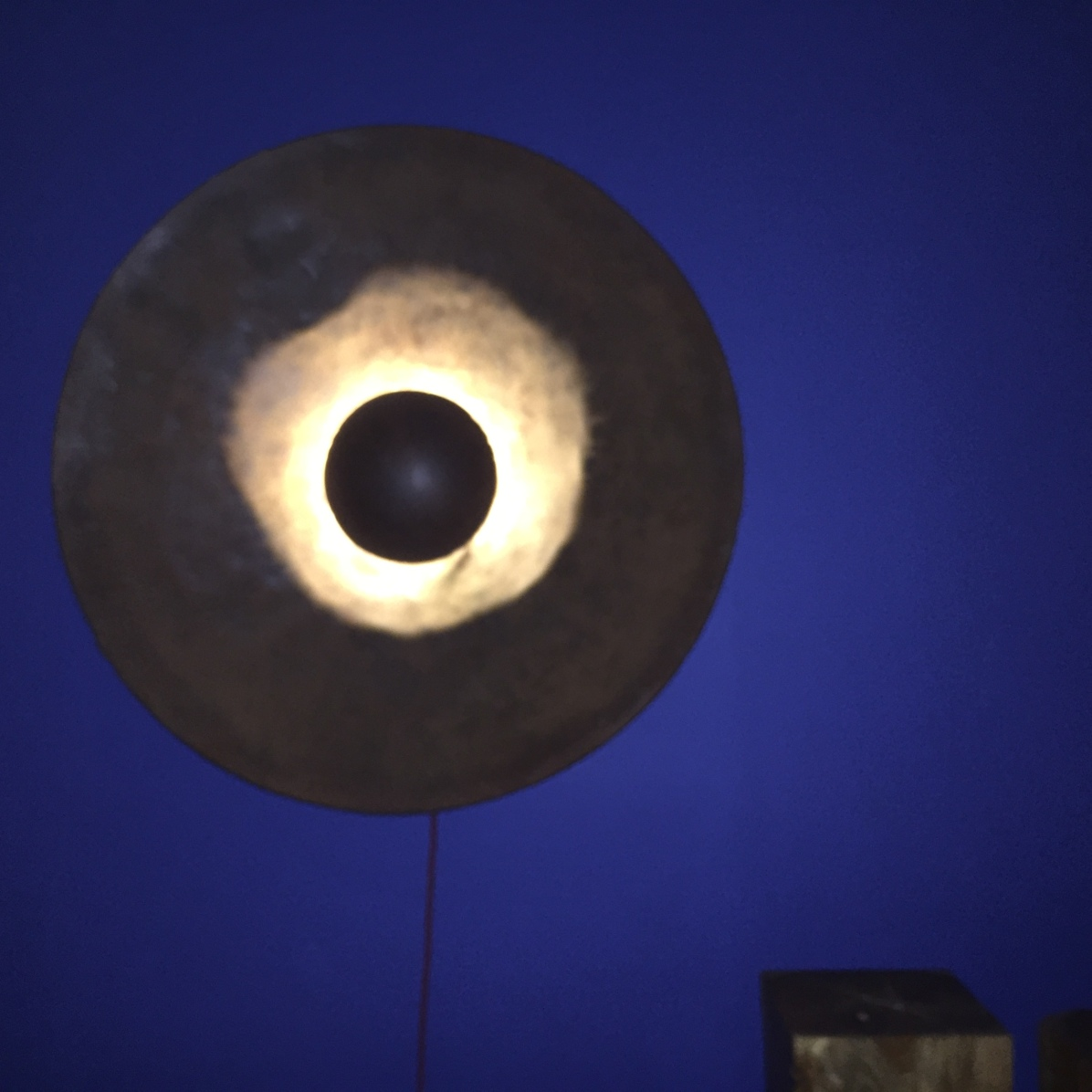 tom + giselle have one of these lights...why not you? resin with a bronzy-copper finish....you need to see it!