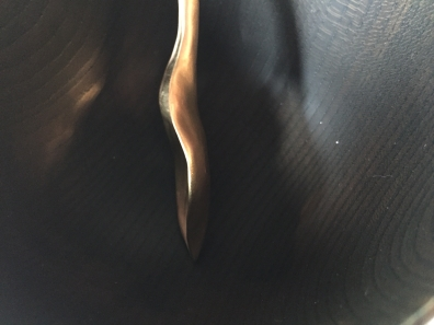 gold hosta spoon black wood bowl